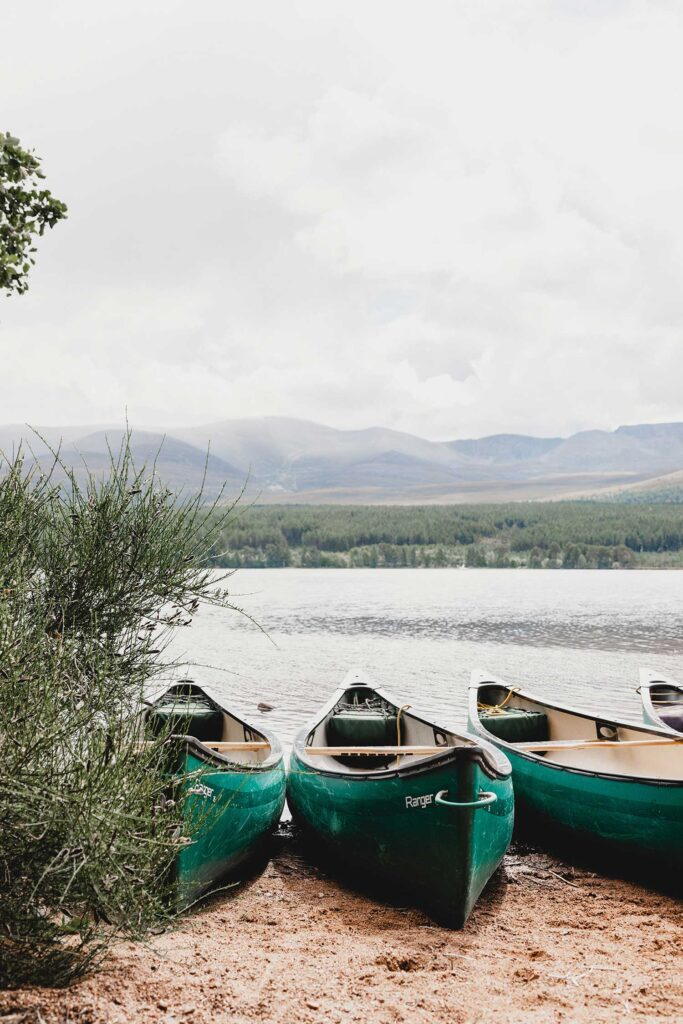 Boats on a lake with mountains in the background. The importance of nature in teaching us.
